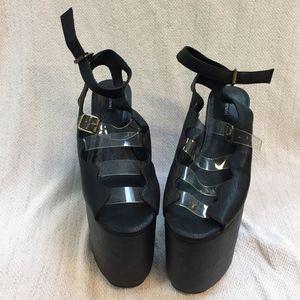 SUBSTITUTE  black floam platform buckle shoes.